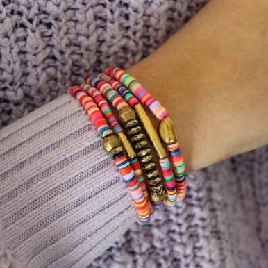 Get Giddy with this bracelet and COLLECT them all. STACK   MIX   BLEND   LAYER Stretch Bracelet. Hand-molded Brass. Silicon.7 inches. Limited Quantities.