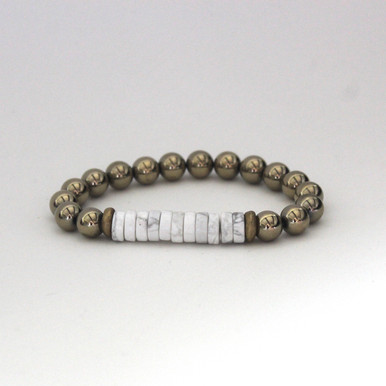 Pyrite with Howlite accent to promote calming strength. Mix|Stack|Blend|Layer|Collect  Handmolded Brass Accent for natural good. Stretch Bracelet. 7 inches. Limited Quantities.