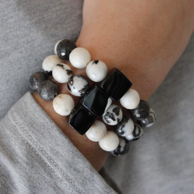 Our take on animal print accents Zebra Jasper and Black Lace Agate to promote optimism and encouragement. Mix|Stack|Blend|Layer|Collect. Stretch Bracelet. 7 inches. Limited Quantities.