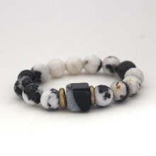 Our take on animal print accents Zebra Jasper and Black Lace Agate to promote optimism and encouragement. Mix|Stack|Blend|Layer|Collect  Handmolded Brass Accent for natural good. Stretch Bracelet. 7 inches. Limited Quantities.