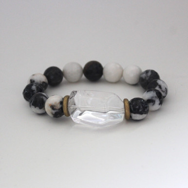 Our take on animal print accents Zebra Jasper with a clear quartz accent to promote clear optimism and encouragement. Mix Stack Blend Layer Collect  Handmolded Brass Accent for natural good. Stretch Bracelet. 7 inches. Limited Quantities.