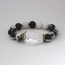 Our take on animal print accents Zebra Jasper with a clear quartz accent to promote clear optimism and encouragement. Mix|Stack|Blend|Layer|Collect  Handmolded Brass Accent for natural good. Stretch Bracelet. 7 inches. Limited Quantities.