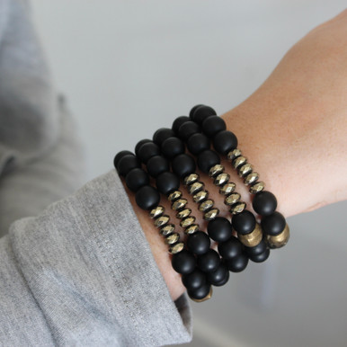 The perfect mix of onyx and pyrite versatile and effortless for every season. Mix|Stack|Blend|Layer|Collect  Handmolded Brass Accent for natural good. Stretch Bracelet. 7 inches. Limited Quantities.