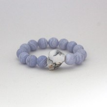 Turn up true communication and enjoy connecting and building friendships with Blue Lace Agate and White Lace Agate. Mix|Stack|Blend|Layer|Collect  Handmolded Brass Accent for natural good. Stretch Bracelet. 7 inches. Limited Quantities.