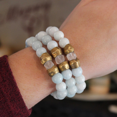The art of the mix! Clear Bliss with this agate and clear quartz accent pack.  Brass=Natural Good. Stretch Bracelet fit small to mid-sized wrist. 7inches. Larger size bracelets available upon request/special order contact customerservice@brynmckenna.com subject line: Special Order Size 8.