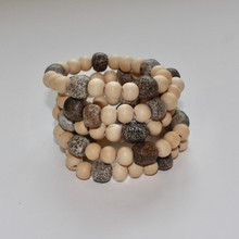 "Feel grounded and gorgeous with our beautifully designed and curated natural pine wood bracelets with raw tumbled fossil stones. ""Nature always wears the colors of the spirit."" - Ralph Waldo Emerson  Stretch Bracelet. Size 7 (small to mid size wrists)"