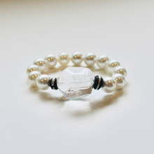 Be inspired with Mother of Pearl and clear quartz for purity, beauty, and CLARITY...this is how understated style gets NOTICED!   Mix|Stack|Blend|Layer|Collect  Stretch Bracelet. 7 inches. Limited Quantities.