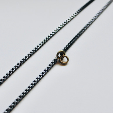 """STEEL the show! This 33"""" stainless steel lariat necklace with brass accents takes center stage for every look. Make it yours with edgy styles or paired with basics to make a statement. This one-of-a-kind piece speaks for itself!"""