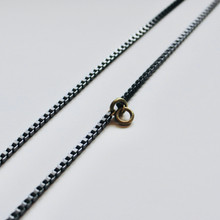 "STEEL the show! This 33"" stainless steel lariat necklace with brass accents takes center stage for every look. Make it yours with edgy styles or paired with basics to make a statement. This one-of-a-kind piece speaks for itself!"