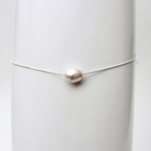 Effortless alone or unlimited layering possibilities. Freshwater pearl. Sterling Silver. Adjustable up to 18inches.