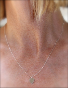 "The ""PICK ME"" Necklace is the perfect gift to let someone know you ""Pick"" her.  Great for MOMs, Daughters, and GFs. The chain is light weight with a small little guitar pick pendant. Adjustable chain extends to 18 inches in length. Sterling Silver Chain, Clasp and Pendant."
