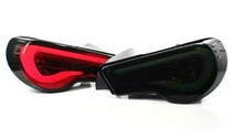 Valenti Sequential LED Taillights - Smoke Lens / White Bar / Black with Chrome Gold Housing
