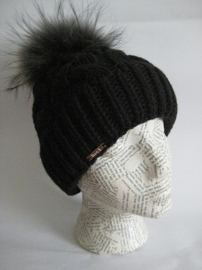 Cable hat with fox pom