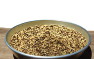 Cooked tricolor instant quinoa, a colorful blend of three seeds - golden, red, and black.