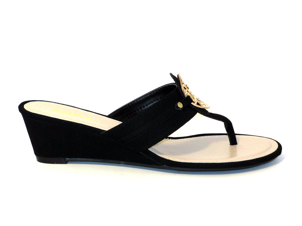 eff3d73afd76 The Dana2 - cute thong wedge sandals come in black with a gold medal  medallion.