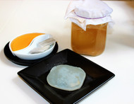 Jun SCOBY looks similar to a kombucha SCOBY but works with completely different substances - It thrives on raw honey and organic green tea.  It has a more delicate flavour than Kombucha and is lighter in colour.   Jun starter comes with of 100 mL mature Jun starter tea and a Jun Scoby (aprox 9i nches) . It can be used to make 1 L of Organic Jun Kombucha tea every 7 days.  Only raw Organic honey, organic green tea and filtered water has been used to grow these Jun SCOBY's