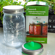 Glass  950ml Mason Jar and lid with fermenting spout and band and small glass weight. These three tools will make fermenting your own vegetables quick and easy, eliminating the risk of mold and the need to monitor your ferment on a daily basis.