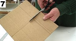 Get an another piece of cardboard for the roof, use blueprints to get exact measurements. Cut where indicated.