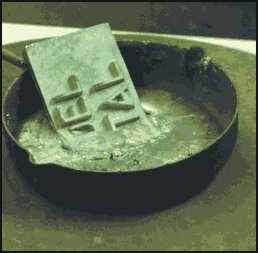 Melt the metal over a electric hob. Use dry metal