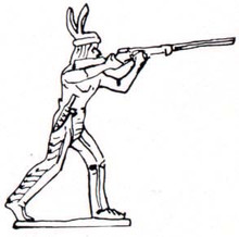 Indian (Native American) standing and firing