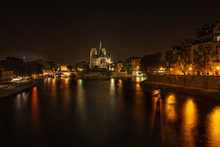 Nighttime at Notre Dame Cathedral from the Pont de la Tournelle bridge.