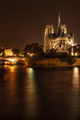 Nighttime at Notre Dame Cathedral from the Pont de la Tournelle bridge. Color Image.