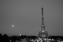 The Eiffel Tower and the full moon rising.