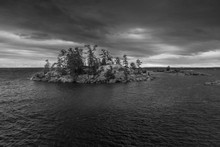 An island in Kilarney Provincial Park, Ontario. A  cloudy and windy day for a hike. Part of the documentary The Sweetwater Seas / Great Lakes Collection. Fine art print on archival paper ready for framing or on an archival canvas wrap printed to the exacting standards of the artist.