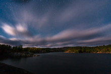 The clouds and stars over George Lake in Kilarney Provincial Park, Ontario. A cloudy and windy day for a hike. Part of the documentary The Sweetwater Seas / Great Lakes Collection. Fine art print on archival paper ready for framing or on an archival canvas wrap printed to the exacting standards of the artist.