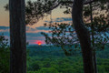 Sunset through the Trees, Peninsula State Park, Wisconsin. Part of the documentary The Sweetwater Seas / Great Lakes Collection. Fine art print on archival paper ready for framing or on an archival canvas wrap printed to the exacting standards of the artist.