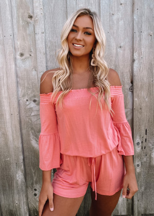 The Easy Life Smocked Off Shoulder Tie Cinched Romper Coral
