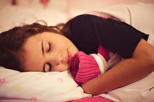 little-girl-cuddling-hot-water-bottle.jpg