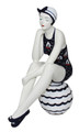 BATHING BEAUTY FIGURINE IN NAVY BLUE SAILBOAT SUIT AND CAP SITTING ON BEACH BALL
