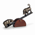 BULL AND BEAR ON MOVEABLE WOODEN SEESAW BASE - STOCK MARKET
