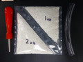 Kit contains 1 and 2 oz bags of tyre beads, a valve core removal tool, and an applicator tube