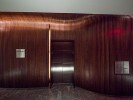 Conrad Hotel Elevator Lobby - a tunnel of bent walnut, fabricated by Pure Timber