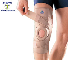 Four neoprene straps provide support directly to patella area.