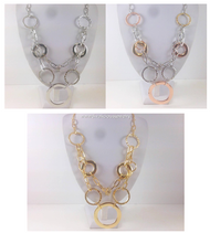 Geometric and Ring-Linked Necklace and Earring Set