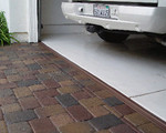 Tsunami Garage Door Threshold Seal in Brown.