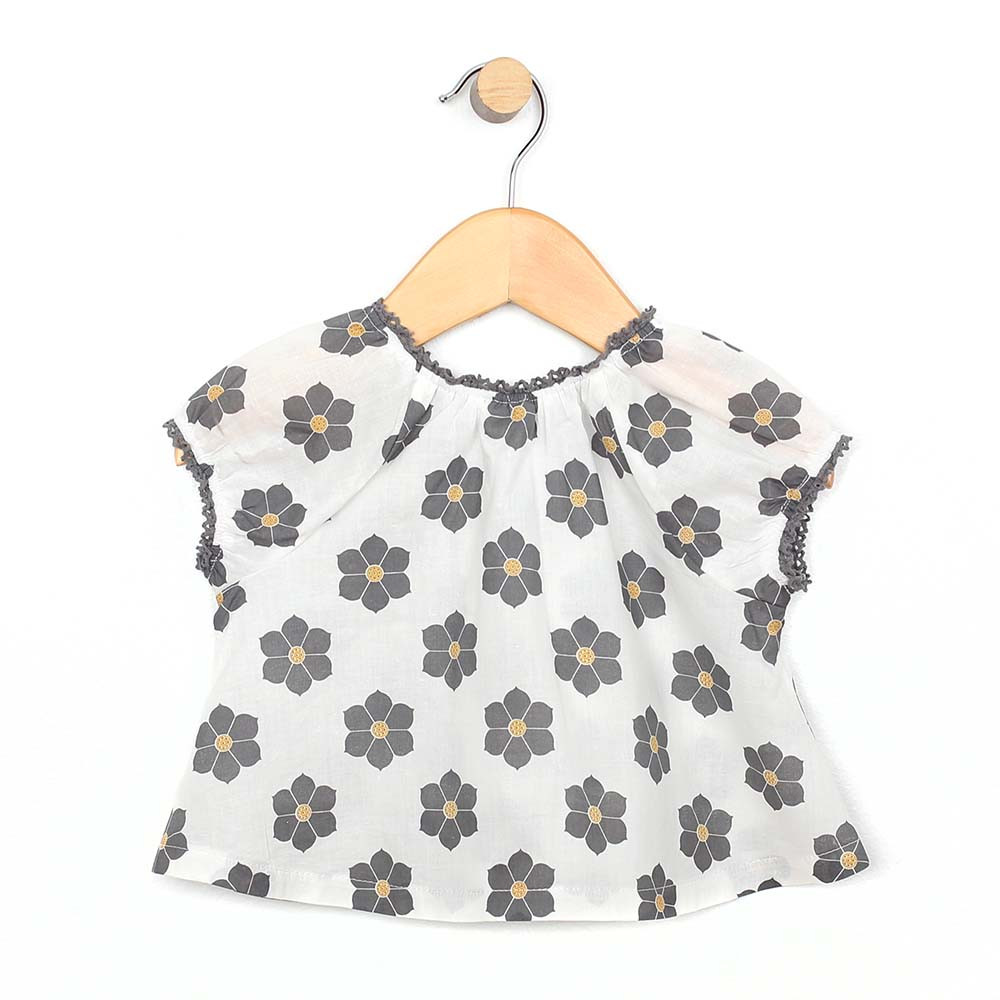White cotton top for baby and toddler girls with grey and yellow flowers.  Back view.