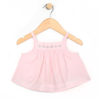 Front view of baby and toddler girl top in pink cotton.