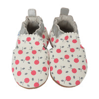White leather infant shoes with soft soles and a cherry design