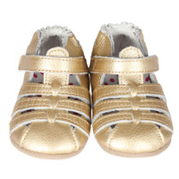 Gold leather shoes for baby girls with rubber in sole.