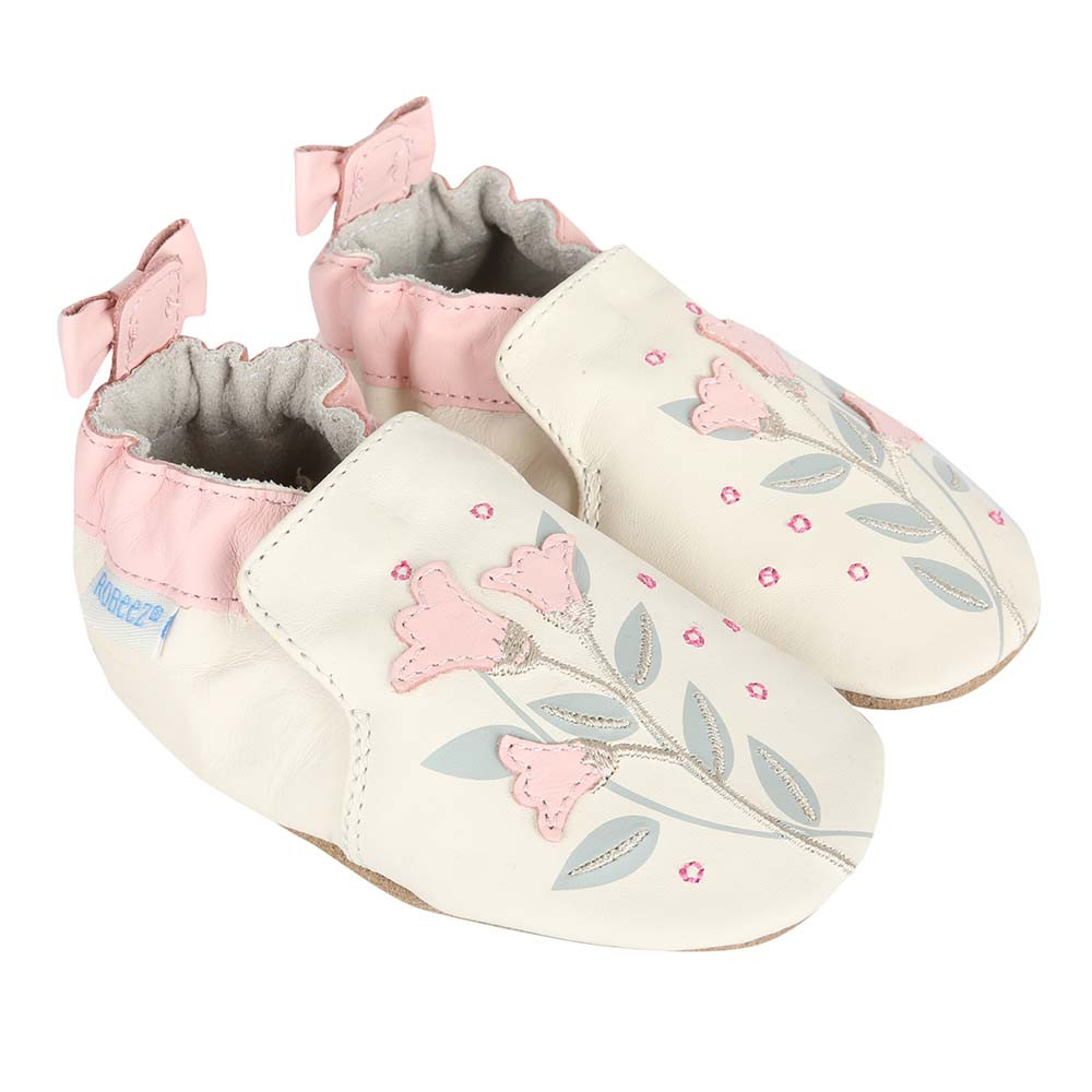 Girls' Baby Shoes in cream leather decorated with pink flowers.   These soft soles are good for babies, infants and toddlers beginning to learn to walk.