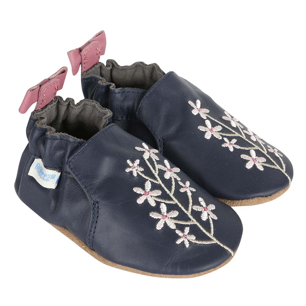 Girls' Baby Shoes in navy leather with embroidered pink flowers.  These soft soles are for babies, infants and toddlers beginning to learn to walk.