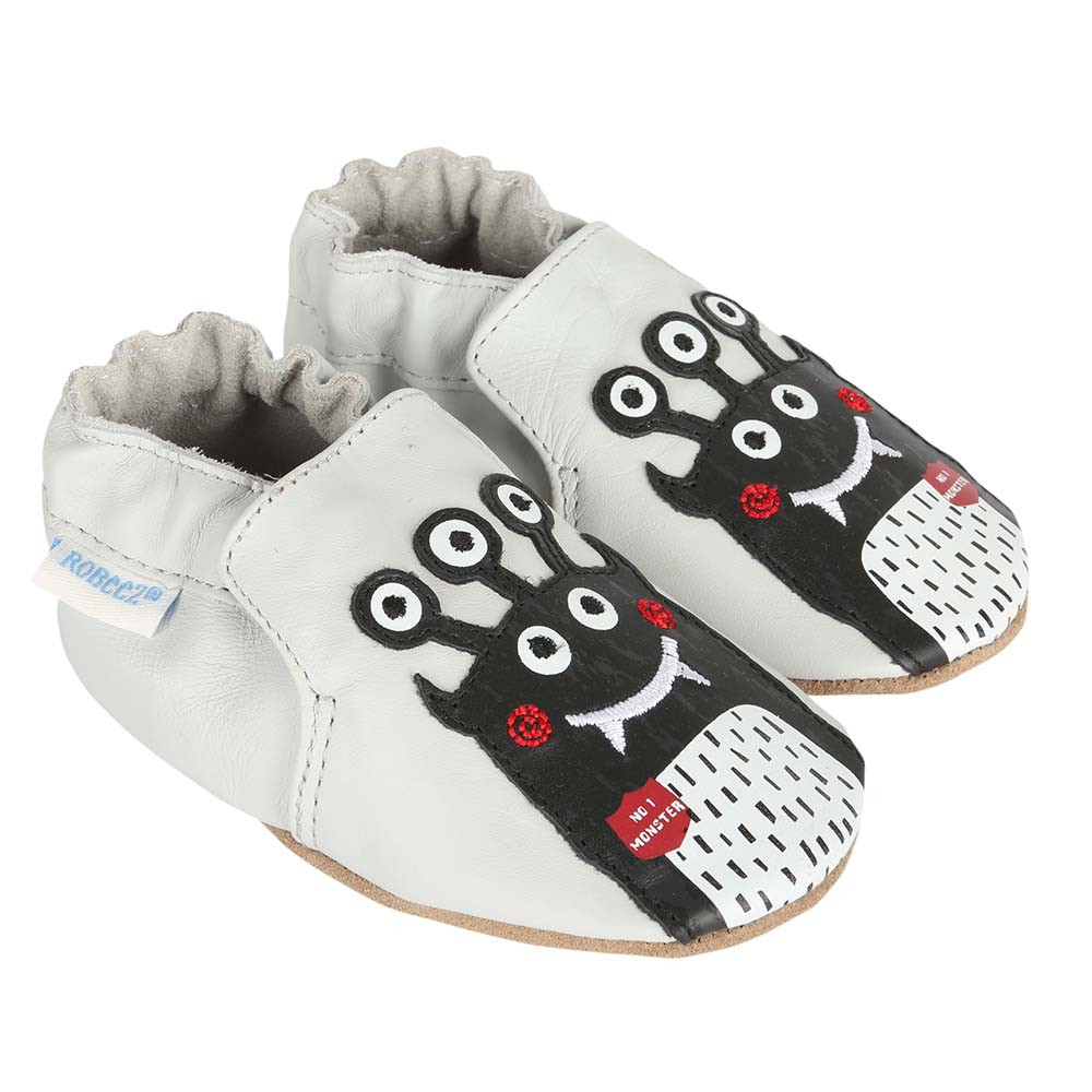 Baby shoes for girls and boys featuring monsters.  Grey leather soft soles.
