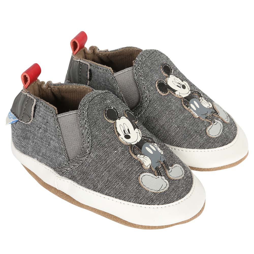Mickey Mouse is featured on this soft soled baby shoe for boys or girls.