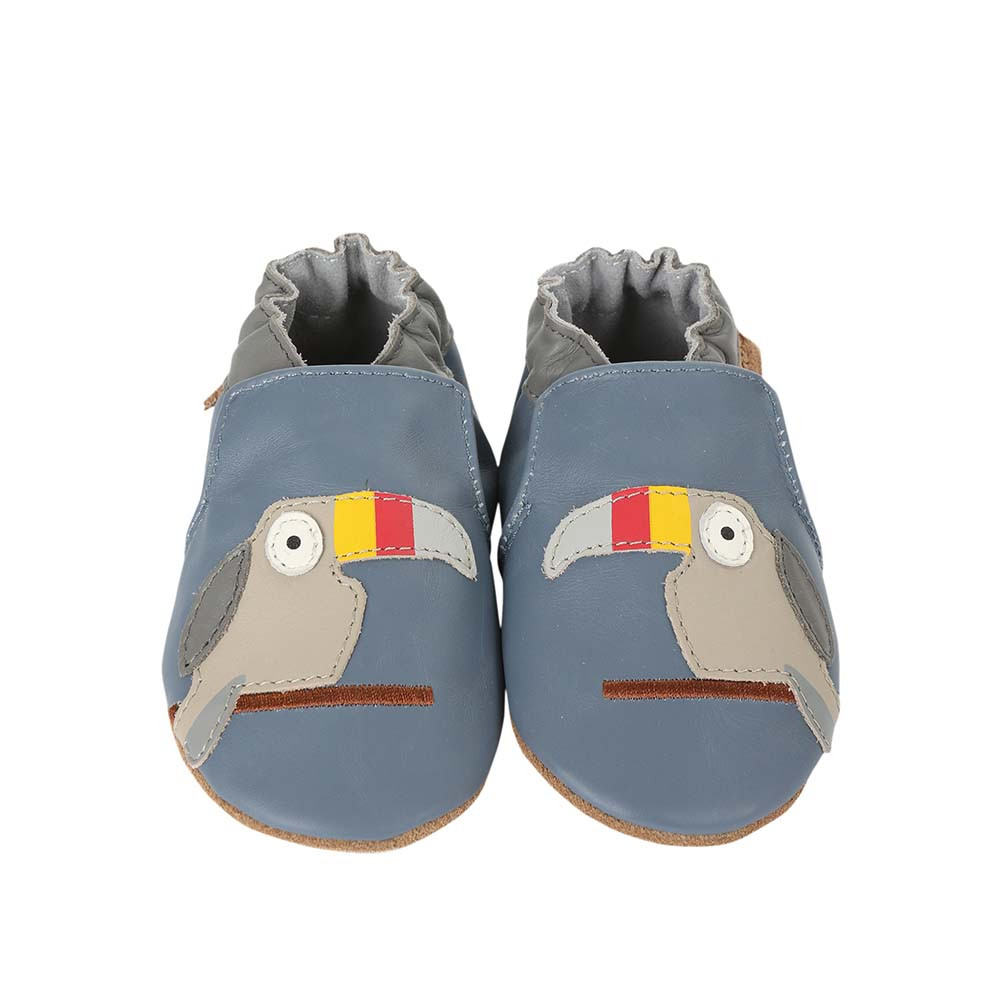 Front view of Toucan Tom Baby Shoes a blue soft sole baby shoe featuring toucans