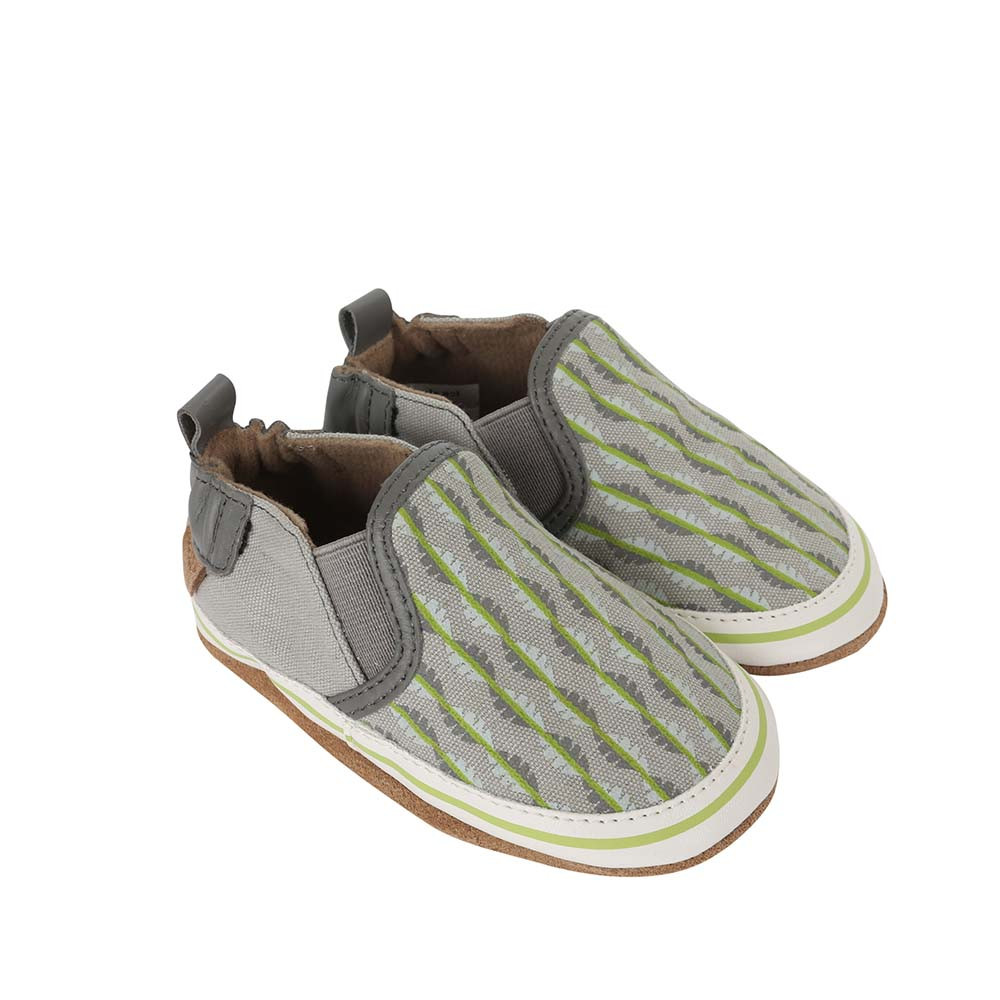 Side view of Liam Tropical Baby shoes, a soft soled crib shoe in grey canvas with a tropical print.