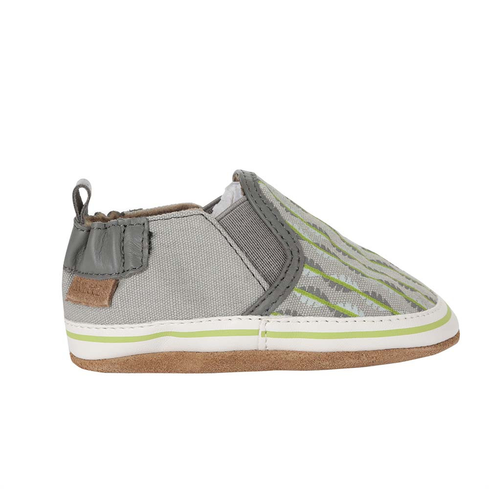 Single side view of Liam Tropical Baby shoes, a soft soled crib shoe in grey canvas with a tropical print.